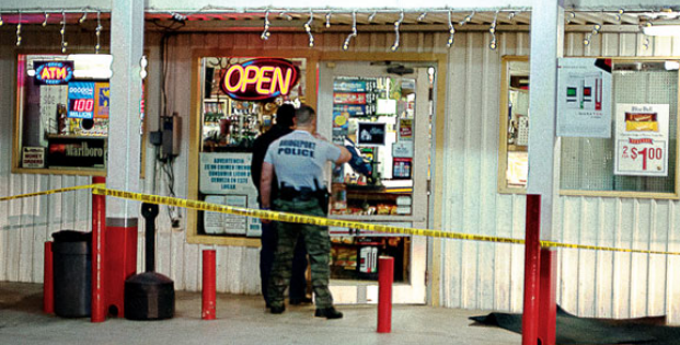 Officers investigate a Dec. 24 robbery at West Side Grocery in Bridgeport. Messenger photo by Jake Harris.