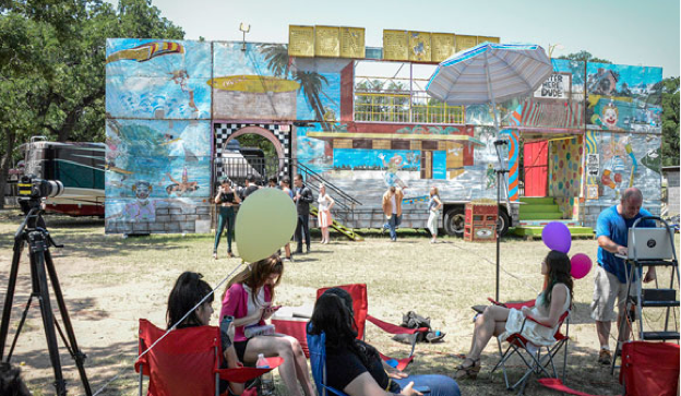 "The fun house that came to Reunion for the carnival is the same one used for the 1978 film ""Grease."" At right is the scene as production of the YouTube video was about to begin. Messenger Photo by Joe Duty."